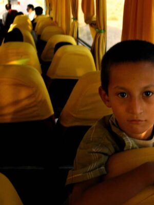 Afghan boy on a bus from the film Pacific Solution